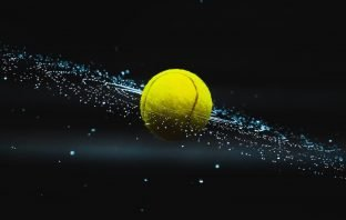 Tennis ball spinning with droplets like a galaxy