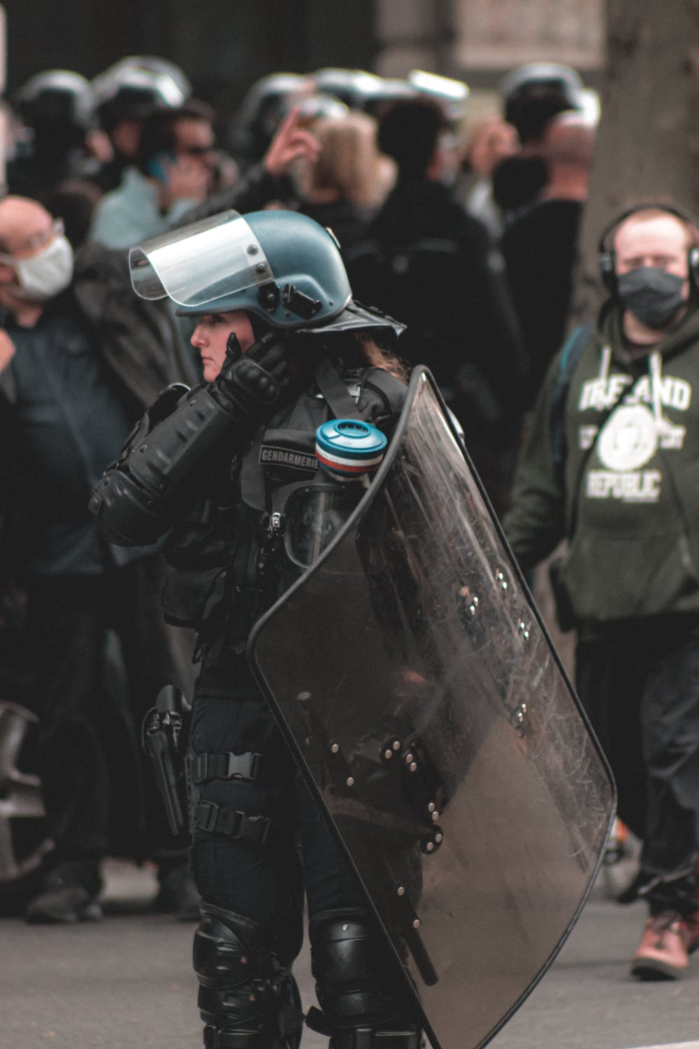 stock photo of a woman in riot police gear